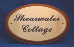 Oval brass Plaque with plinth